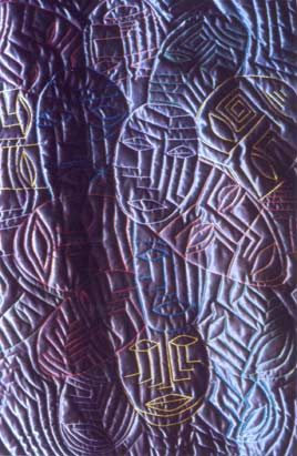 Satin quilt with embroidered cubist faces